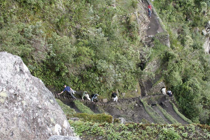 Tourists descending the stairs of death