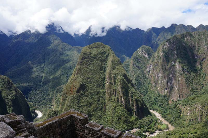The happy mountain, Putucusi, rises next to Machu Picchu