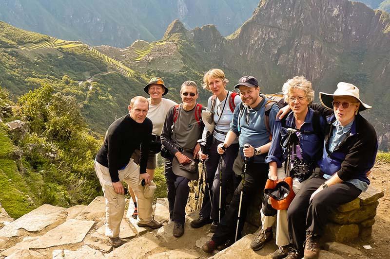 Older adults climbing the mountain Machu Picchu