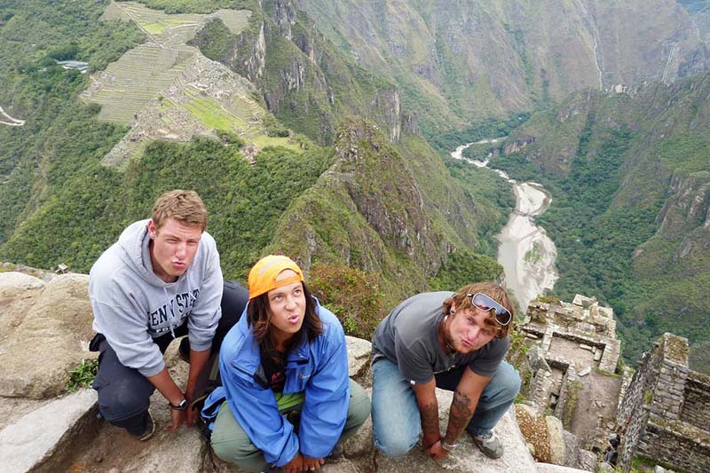 Tourists at the top of the mountain Huayna Picchu