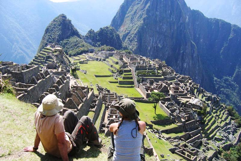 Tourists appreciating the majesty of the citadel of Machu Picchu