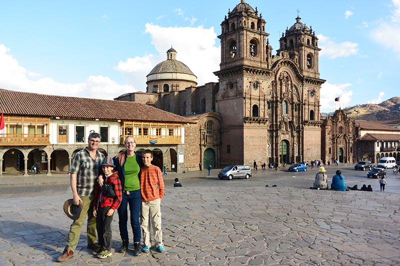 Family with children in the main square of Cusco