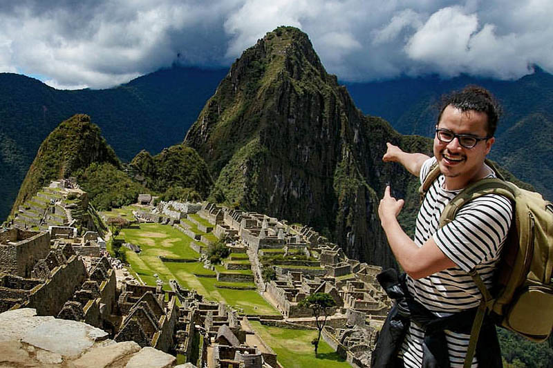 Happy tourist in Machu Picchu