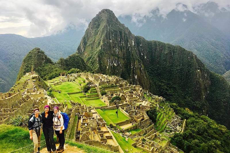 Group of tourists in Machu Picchu