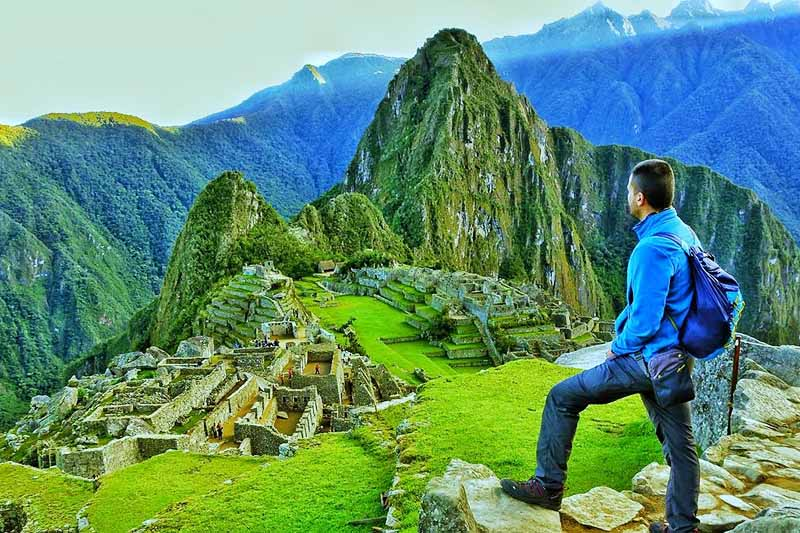 Tourist in Machu Picchu at sunrise