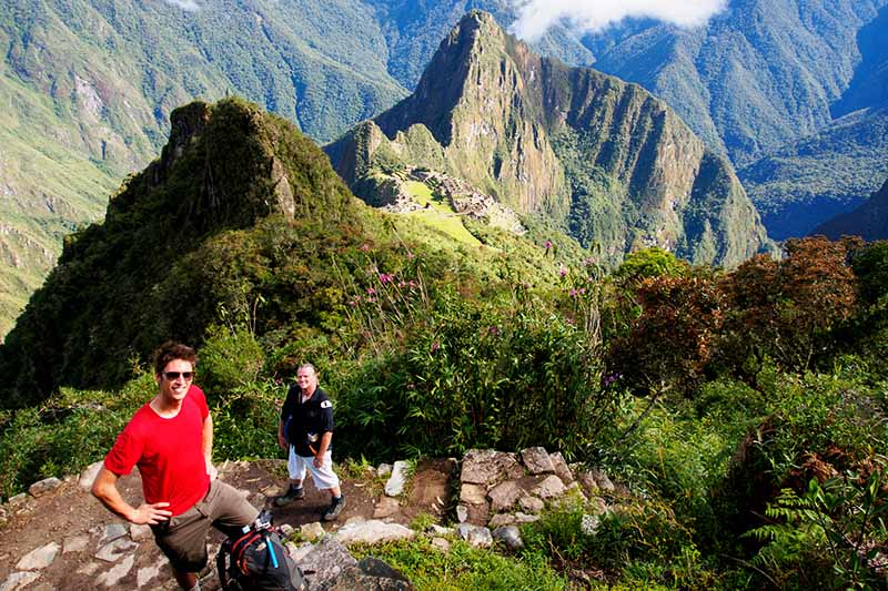 Tourist touring the Machu Picchu mountain to the top