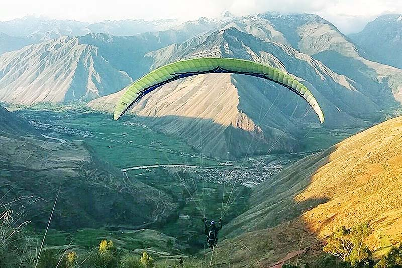 Tourist practicing paragliding in the Sacred Valley of the Incas