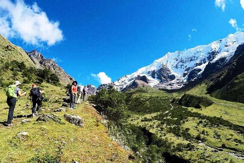 Tourist trekking through Salkantay mountain