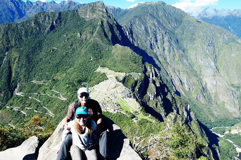 Older adults on the top of the mountain Huayna Picchu
