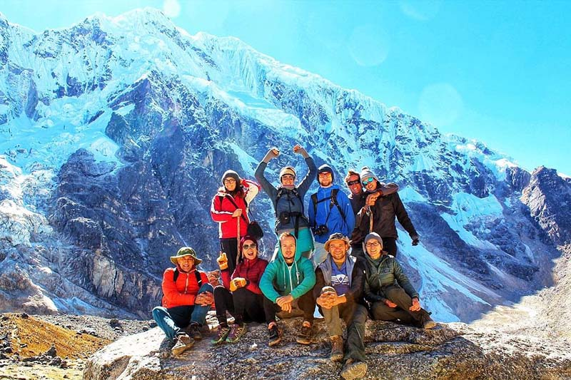 Tourists at the foot of the Salkantay mountain